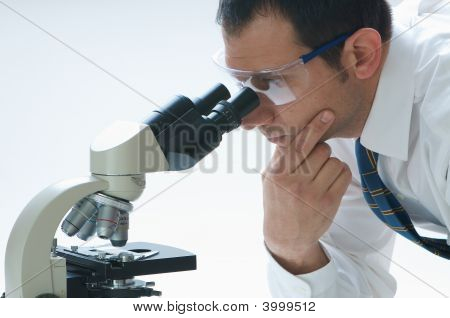 Sceientist And Microscope