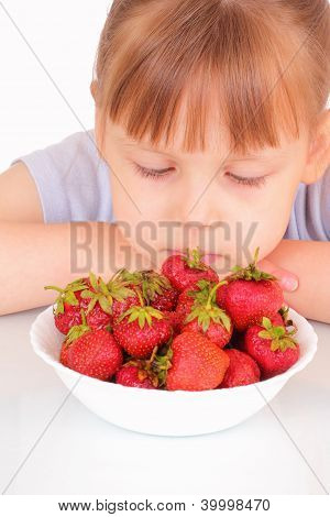 Beautiful Little Girl And A White Soup Plate With Strawberries