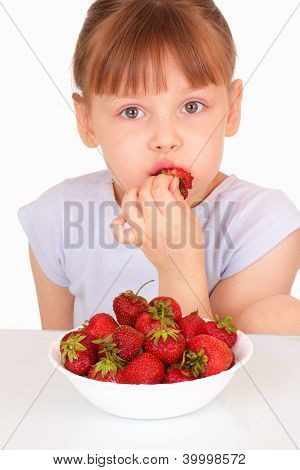 Beautiful Little Girl Eating Tasty Strawberries