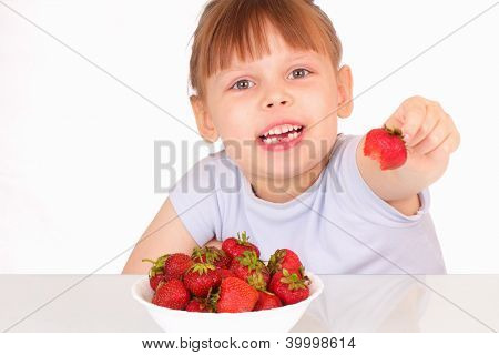 Beautiful Little Girl Gives Strawberry