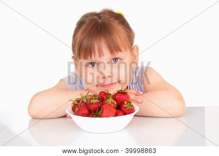 Pretty Little Girl And A White Soup Plate With Strawberries