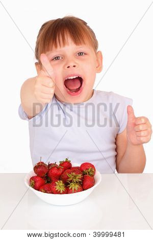 Happy Little Girl With A White Soup Plate With Strawberries