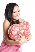 foto of heart shape  - A beautiful asian woman hugging a heart - JPG