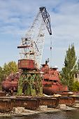 pic of shipbuilding  - Shipbuilding cranes and some sea ships near a pier - JPG