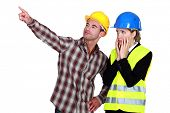 female architect looking appalled and male builder