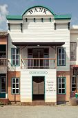 picture of gunfighter  - Western style Bank in an old American town - JPG