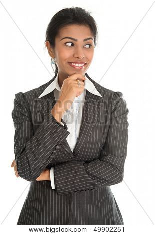 Portrait of beautiful African American businesswoman in business suit thinking, isolated over white background. Mixed race Asian Indian and African American model.