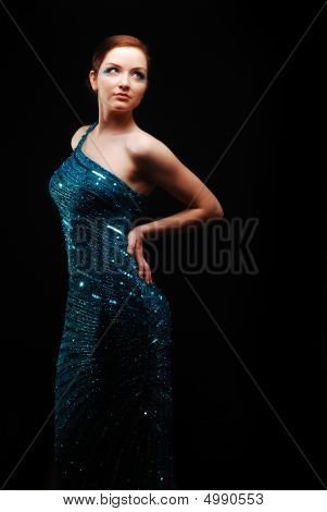 Glamourous Woman Dancing/posing In Blue Dress
