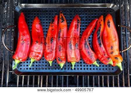 Chillies Getting Ready To Be Grilled On The Grill