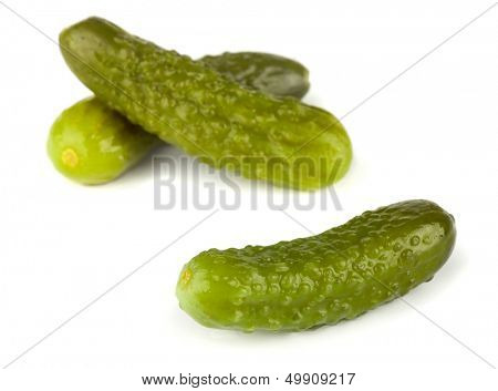 Three pickled gherkins isolated on white background