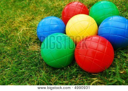 Vibrant Multi Coloured Balls On Grass