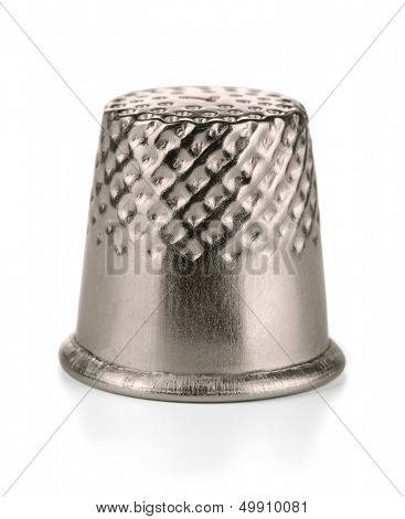 Metal sewing thimble isolated on white