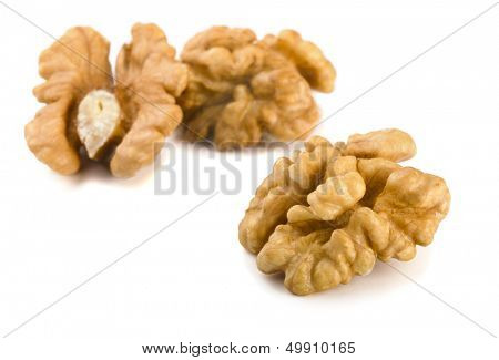Group of peeled walnuts isolated on a white