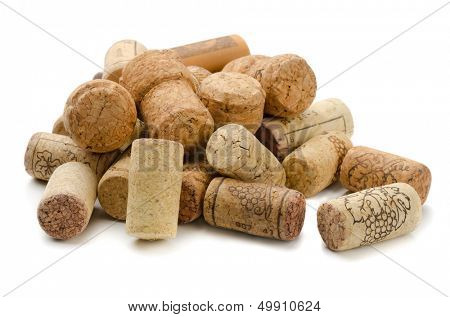 Stack of wine corks on white background