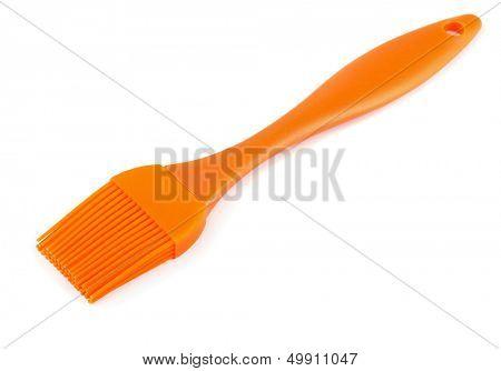 Orange silicone pastry brush isolated on white