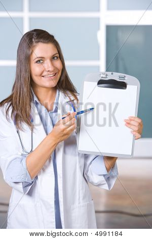 Female Doctor Holding Blank Chart