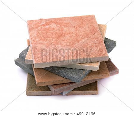 Stack of various stone tiles isolated on white