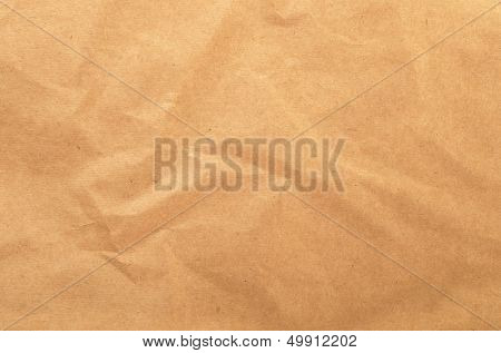 Brown rough crumpled recycled paper texture