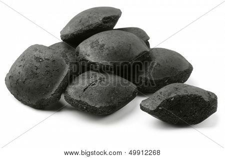Coco charcoal briquetts isolated on white