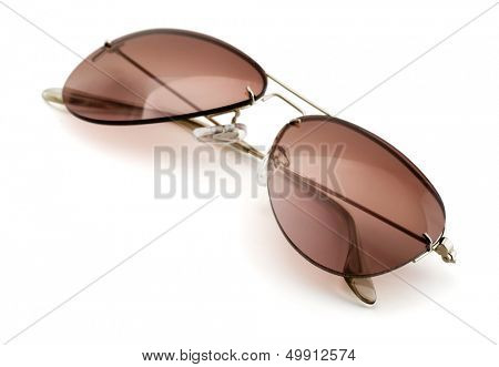 Brown aviator style sunglasses isolated on white