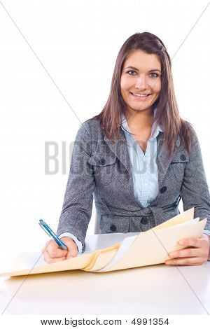 Business Woman Writing Notes At Desk