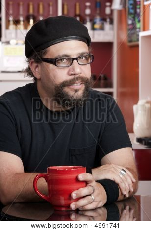 Man Wearing Beret In Coffee House