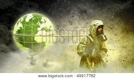 Man in respirator against nuclear background. Global pollution
