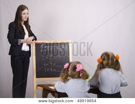 Girl teacher teaches two disciples