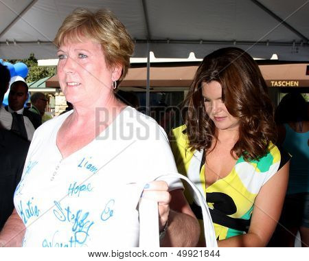 LOS ANGELES - AUG 23:  Heather Tom autographing a fan's T shirt at the Bold and Beautiful Fan Meet and Greet at the Farmers Market on August 23, 2013 in Los Angeles, CA