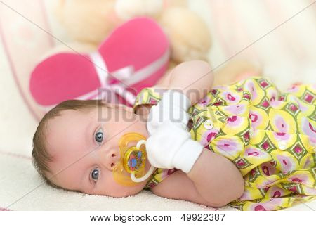 1 month old baby girl with pacifier