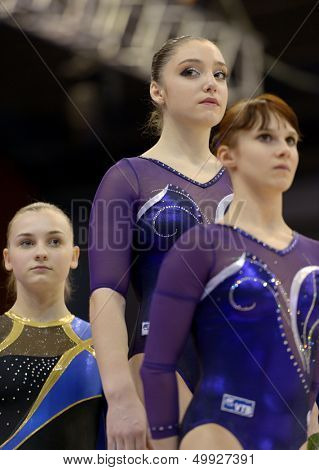 KIEV, UKRAINE - MARCH 30: Anna Dementieva (right), Aliya Mustafina (middle), both - Russia, and Kristina Sankova (left) Ukraine win Stella Zakharova Cup in Kiev, Ukraine on March 30, 2013