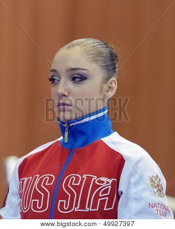 KIEV, UKRAINE - MARCH 31: Aliya Mustafina of Russia before the competition on uneven bars during International Tournament in Artistic Gymnastics Stella Zakharova Cup in Kiev, Ukraine on March 31, 2013