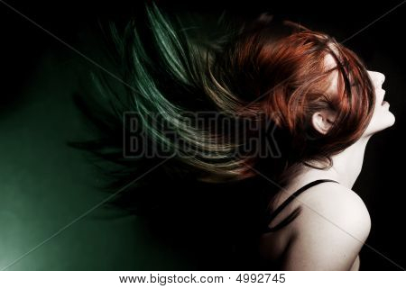 Attractive Model Swinging Her Hair.