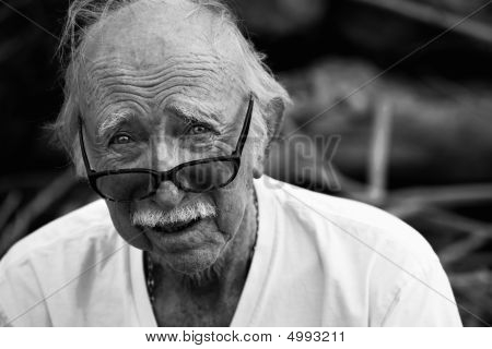 Elderly Man In T-shirt And Glasses