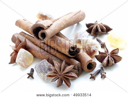 Christmas spices - cinnamon, cloves, star anise on white background