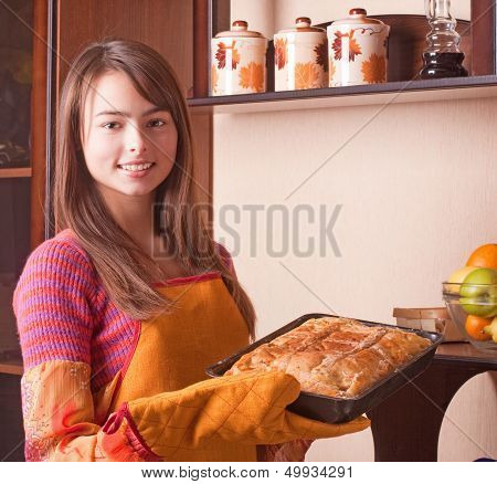 Beautiful Girl With Cake In Kitchen