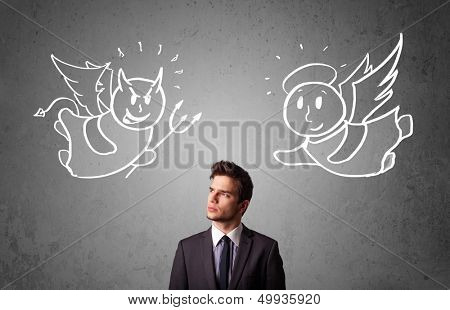 Young businessman standing between the angel and the devil drawings