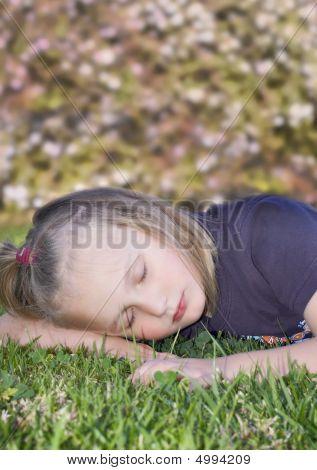 Girl Sleeping On The Grass
