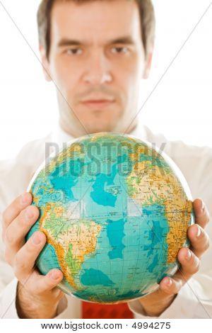 Man Holding The Globe