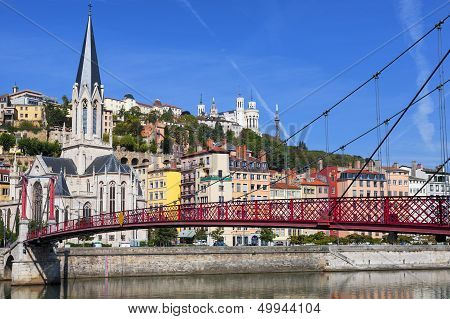View Of Lyon City And Red Footbridge