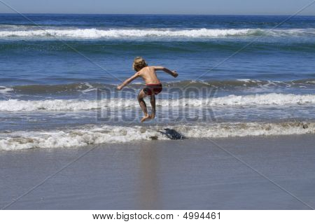 Boy  Jumping In The Waves