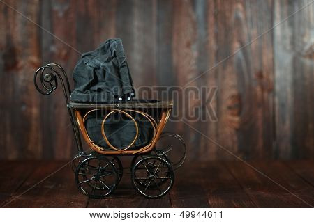 Antique Infant Baby Cradle on Grunge Wooden Background