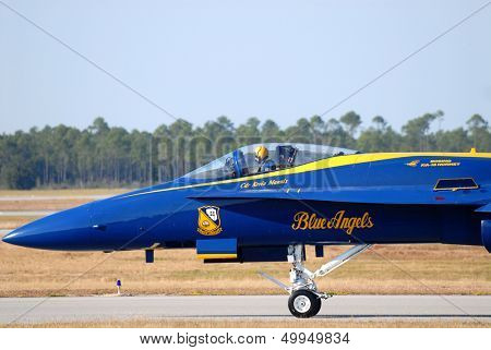 A closeup of the pilot in the cockpit of a Navy Blue Angel FA-18 Hornet awaiting takeoff