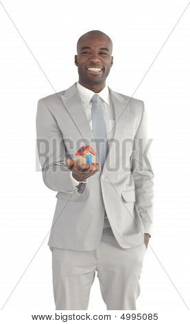 Businessman Holding A House In His Hands