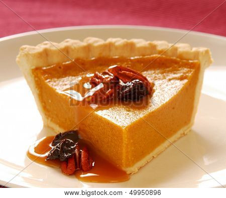 Freshly baked pumpkin pie with pecans, cranberries and a carmel sauce