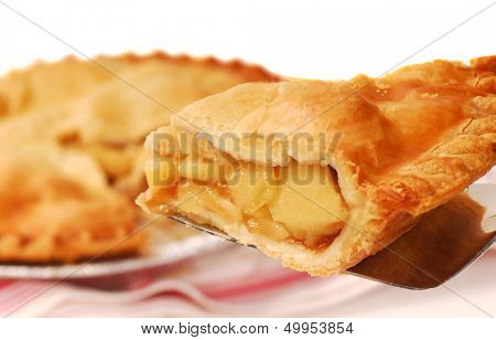 Delicious slice of freshly baked apple pie on a spatula