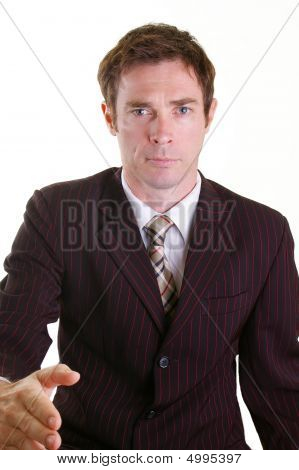 Business Man In Pinstripped Suit Giving Handshake Gesture
