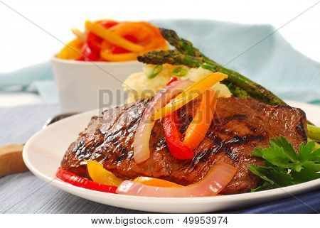 Grilled rib-eye steak with mashed potatoes and asparagus