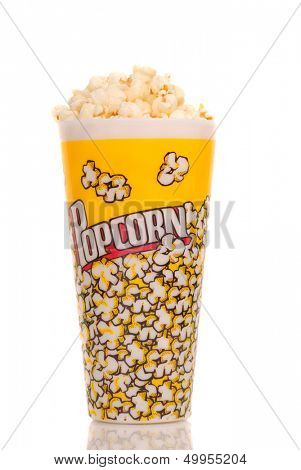 Container of delicious movie popcorn on white