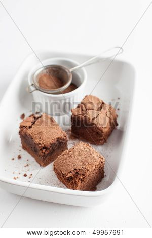 Chocolate Brownies On Plate Served With Vintage Sifter